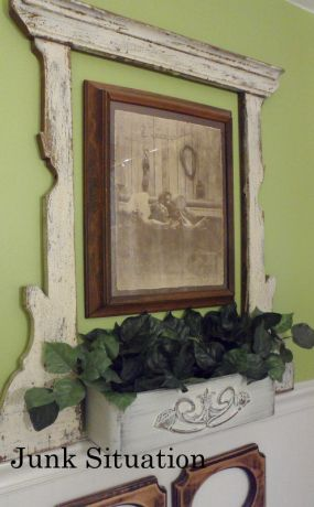 Vanity mirror-frame can jazz up wall art by simply hanging it over (or under) the grouping.