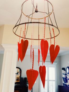 This perfectly rusty lamp shade frame has patiently waited for decades to begin its second life. By simply wrapping the stems of the heart leaves with bakers twine and knotting them to the shade frame a fun little Valentines decoration was born.